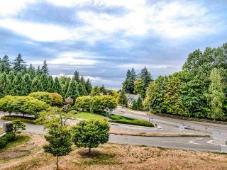 "Photo 1: 305 6093 IONA Drive in Vancouver: University VW Condo for sale in ""Coast"" (Vancouver West)  : MLS®# R2489520"