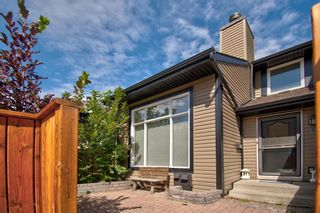 Photo 1: 33 12625 24 Street SW in Calgary: Woodbine Row/Townhouse for sale : MLS®# A1024198