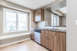 Photo 11: 145 WINDSTONE Avenue SW: Airdrie Row/Townhouse for sale : MLS®# C4260990