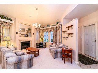 "Photo 3: 28 16920 80 Avenue in Surrey: Fleetwood Tynehead Townhouse for sale in ""Stone Ridge"" : MLS®# F1428666"