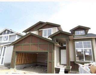 Main Photo: 170 Luxstone Road in Airdrie: House for sale : MLS®# C3325897