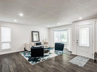 Photo 3: 171 Woodstock Place SW in Calgary: Woodlands Detached for sale : MLS®# A1047853