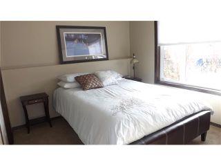 Photo 20: 155 SUNSET Close: Cochrane House for sale : MLS®# C4037159