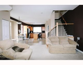 Photo 2: 23605 DEWDNEY TRUNK RD in Maple Ridge: Condo for sale : MLS®# V757687