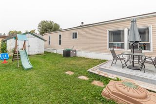 Photo 16: 111 Heritage Drive: Okotoks Mobile for sale : MLS®# A1102220