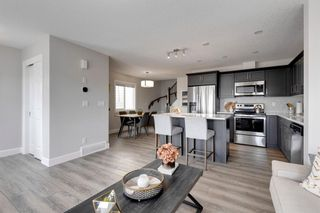 Photo 5: 144 Yorkville Avenue SW in Calgary: Yorkville Row/Townhouse for sale : MLS®# A1145393