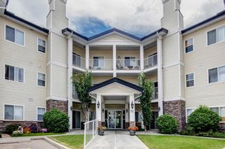 Photo 1: 111 72 Quigley Drive: Cochrane Apartment for sale : MLS®# A1137797