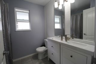 """Photo 12: 18486 65 Avenue in Surrey: Cloverdale BC House for sale in """"Clover Valley Station"""" (Cloverdale)  : MLS®# R2201415"""