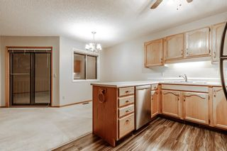 Photo 8: 10 Sandarac Circle NW in Calgary: Sandstone Valley Row/Townhouse for sale : MLS®# A1145487
