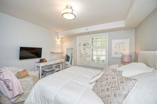 Photo 10: 117 6868 Sierra Morena Boulevard SW in Calgary: Signal Hill Apartment for sale : MLS®# A1122114