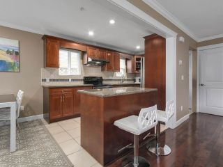 """Photo 7: 8445 FREMLIN Street in Vancouver: Marpole 1/2 Duplex for sale in """"MARPOLE"""" (Vancouver West)  : MLS®# R2135044"""