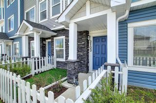 Photo 1: 2103 Jumping Pound Common: Cochrane Row/Townhouse for sale : MLS®# A1119563