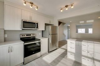Photo 19: 226 Cranbrook Square in Calgary: Cranston Row/Townhouse for sale : MLS®# A1093078