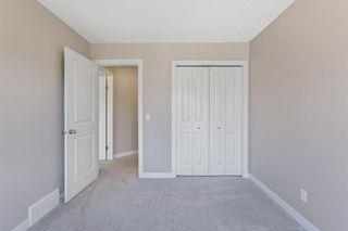 Photo 32: 144 Heritage Boulevard: Cochrane Detached for sale : MLS®# A1125296