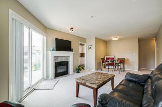 "Photo 5: 406 8142 120A Street in Surrey: Queen Mary Park Surrey Condo for sale in ""Sterling Court"" : MLS®# R2381590"