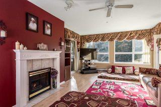 "Photo 2: 301 9626 148 Street in Surrey: Guildford Condo for sale in ""Hartford Woods"" (North Surrey)  : MLS®# R2250876"