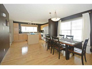 Photo 3: 112 TUSCANY SPRINGS Gardens NW in CALGARY: Tuscany Townhouse for sale (Calgary)  : MLS®# C3604251