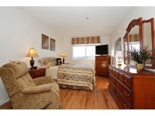 "Photo 11: 311 5955 177B Street in Surrey: Cloverdale BC Condo for sale in ""WINDSOR PLACE"" (Cloverdale)  : MLS®# F1433073"