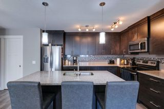 Photo 3: 203 Evanston Manor NW in Calgary: Evanston Row/Townhouse for sale : MLS®# A1149522