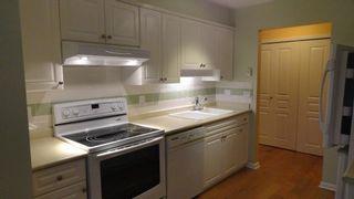 Photo 7: 106 6363 121st Street in Surrey: Panorama Ridge Condo for sale : MLS®# F1435469
