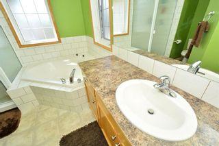 Photo 22: 12 BOW RIDGE Drive: Cochrane House for sale : MLS®# C4129947