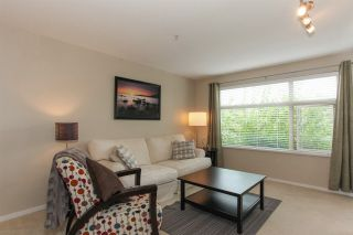 """Photo 2: 209 400 KLAHANIE Drive in Port Moody: Port Moody Centre Condo for sale in """"Tides"""" : MLS®# R2192368"""