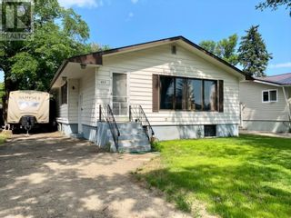 Photo 3: 415 3A Street W in Brooks: House for sale : MLS®# A1129371