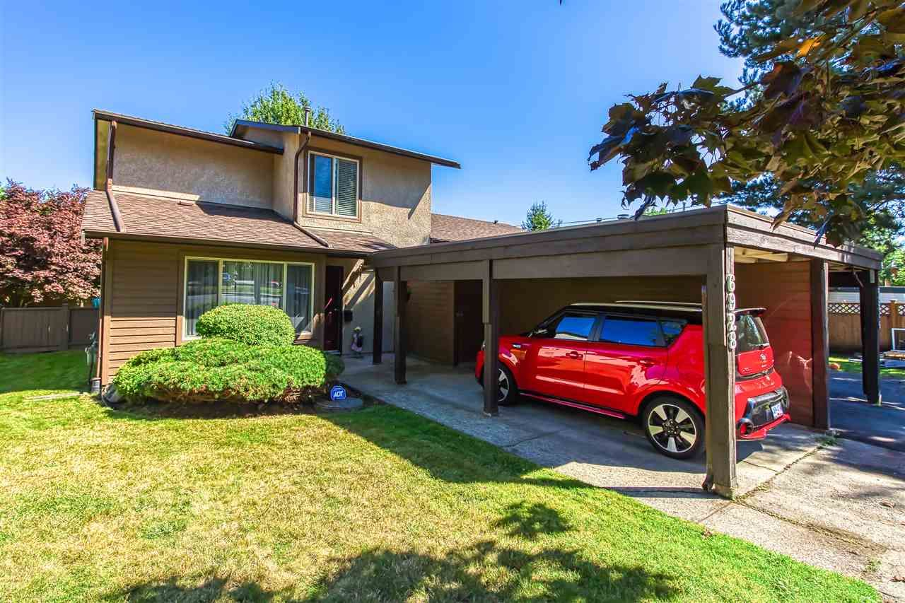 """Main Photo: 6928 134 Street in Surrey: West Newton 1/2 Duplex for sale in """"BENTLEY"""" : MLS®# R2490871"""