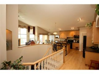 Photo 13: 313 GLENEAGLES View: Cochrane House for sale : MLS®# C4047766