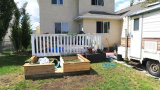 Photo 4: 907 WESTMOUNT Drive: Strathmore Semi Detached for sale : MLS®# A1119443
