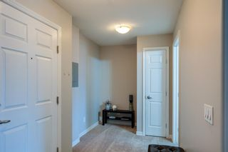 Photo 3: 3310 92 Crystal Shores Road: Okotoks Apartment for sale : MLS®# A1066113