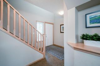 Photo 2: 55 Cougar Ridge Court SW in Calgary: Cougar Ridge Detached for sale : MLS®# A1110903