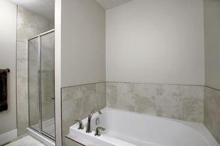 Photo 14: 374 Quarry Park Boulevard SE in Calgary: Douglasdale/Glen Row/Townhouse for sale : MLS®# A1063797
