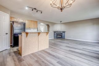 Photo 7: 52 COUGARSTONE Villa SW in Calgary: Cougar Ridge Detached for sale : MLS®# A1020063