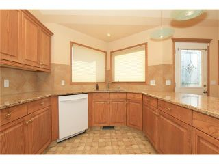 Photo 12: 183 WEST MCDOUGAL Road: Cochrane House for sale : MLS®# C4088134