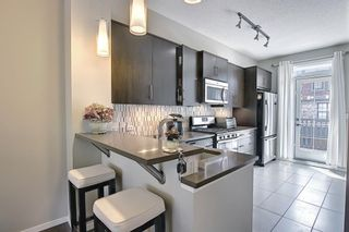 Photo 5: 314 Ascot Circle SW in Calgary: Aspen Woods Row/Townhouse for sale : MLS®# A1111264