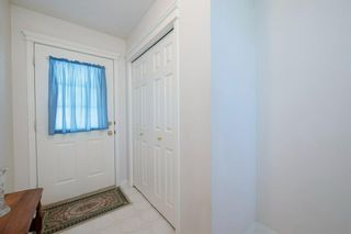 Photo 2: 38 Country Hills Cove NW in Calgary: Country Hills Row/Townhouse for sale : MLS®# A1116176