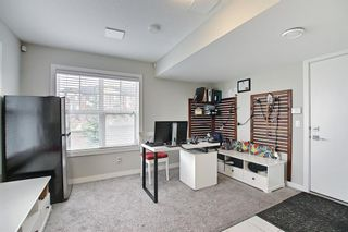 Photo 11: 111 Evanscrest Gardens NW in Calgary: Evanston Row/Townhouse for sale : MLS®# A1135885