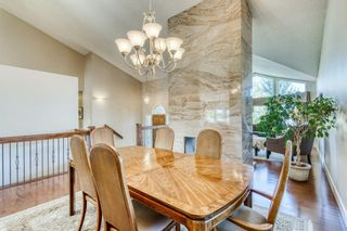 Photo 9: 555 Coach Light Bay SW in Calgary: Coach Hill Detached for sale : MLS®# A1144688