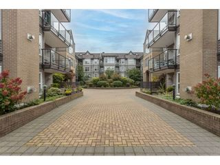 "Photo 1: 405 20200 56 Avenue in Langley: Langley City Condo for sale in ""The Bentley"" : MLS®# R2530044"