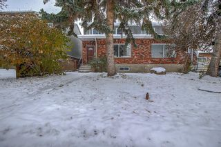 Photo 1: 834 68 Avenue SW in Calgary: Kingsland Semi Detached for sale : MLS®# A1059383