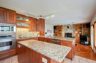 Photo 9: 27 Strathlorne Bay SW in Calgary: Strathcona Park Detached for sale : MLS®# A1120430
