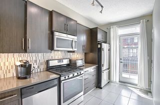 Photo 3: 314 Ascot Circle SW in Calgary: Aspen Woods Row/Townhouse for sale : MLS®# A1111264