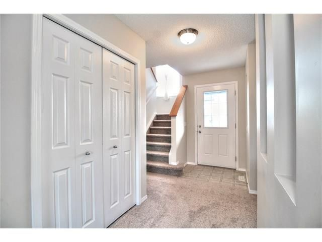 Photo 5: Photos: 606 EVERMEADOW Road SW in Calgary: Evergreen House for sale : MLS®# C4053479