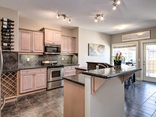 Photo 1: 1613 STRATHCONA Drive SW in Calgary: Strathcona Park House for sale : MLS®# C4005151