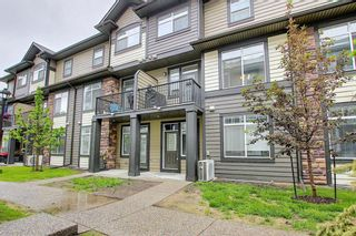 Photo 1: 213 Wentworth Row SW in Calgary: West Springs Row/Townhouse for sale : MLS®# A1123522