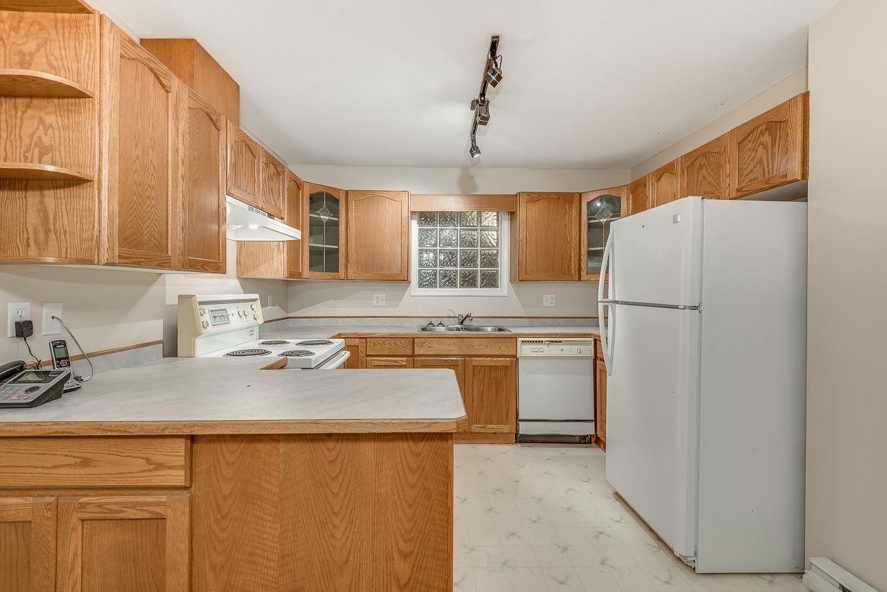 Main Photo: 211 12025 207A STREET in Maple Ridge: Northwest Maple Ridge Condo for sale : MLS®# R2265253