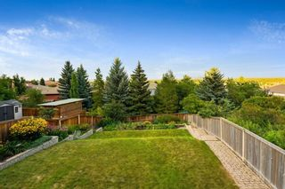 Photo 8: 217 Signature Way SW in Calgary: Signal Hill Detached for sale : MLS®# A1148692