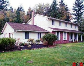 Photo 1: 5763 136TH Street in Surrey: Panorama Ridge House for sale : MLS®# F2900516