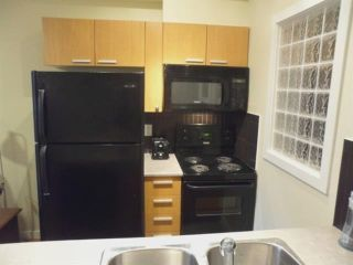 """Photo 3: 202 10455 UNIVERSITY Drive in Surrey: Whalley Condo for sale in """"D'COR"""" (North Surrey)  : MLS®# R2314923"""